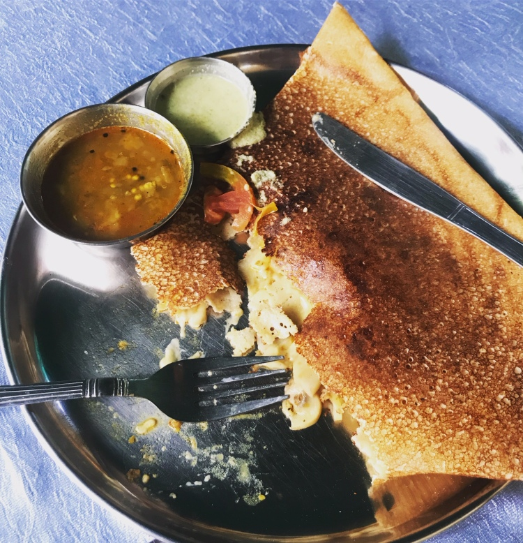 Cheese and tomato filled dosa