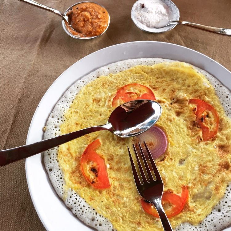Egg dosa with onion and tomato