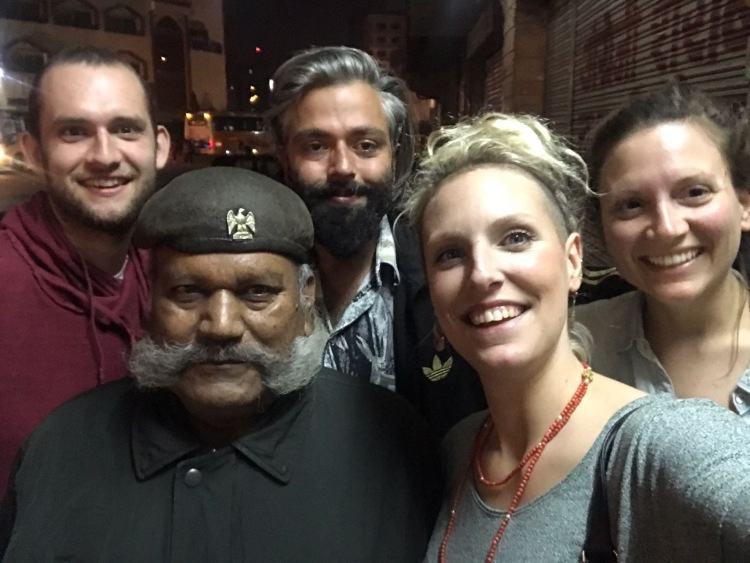 Friend group with Indian security guard