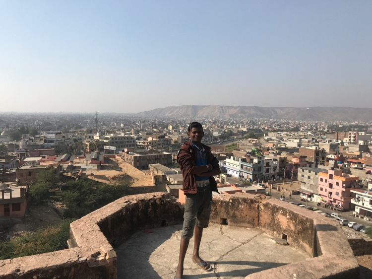 Indian tour guide in front of Jaipur city view