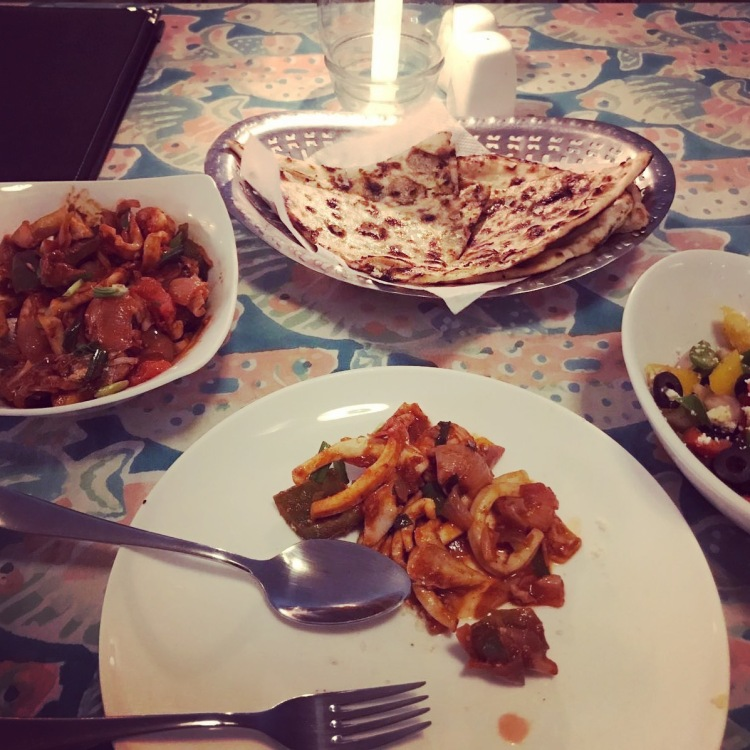 Spicy seafood chilli fry with paratha in Goa