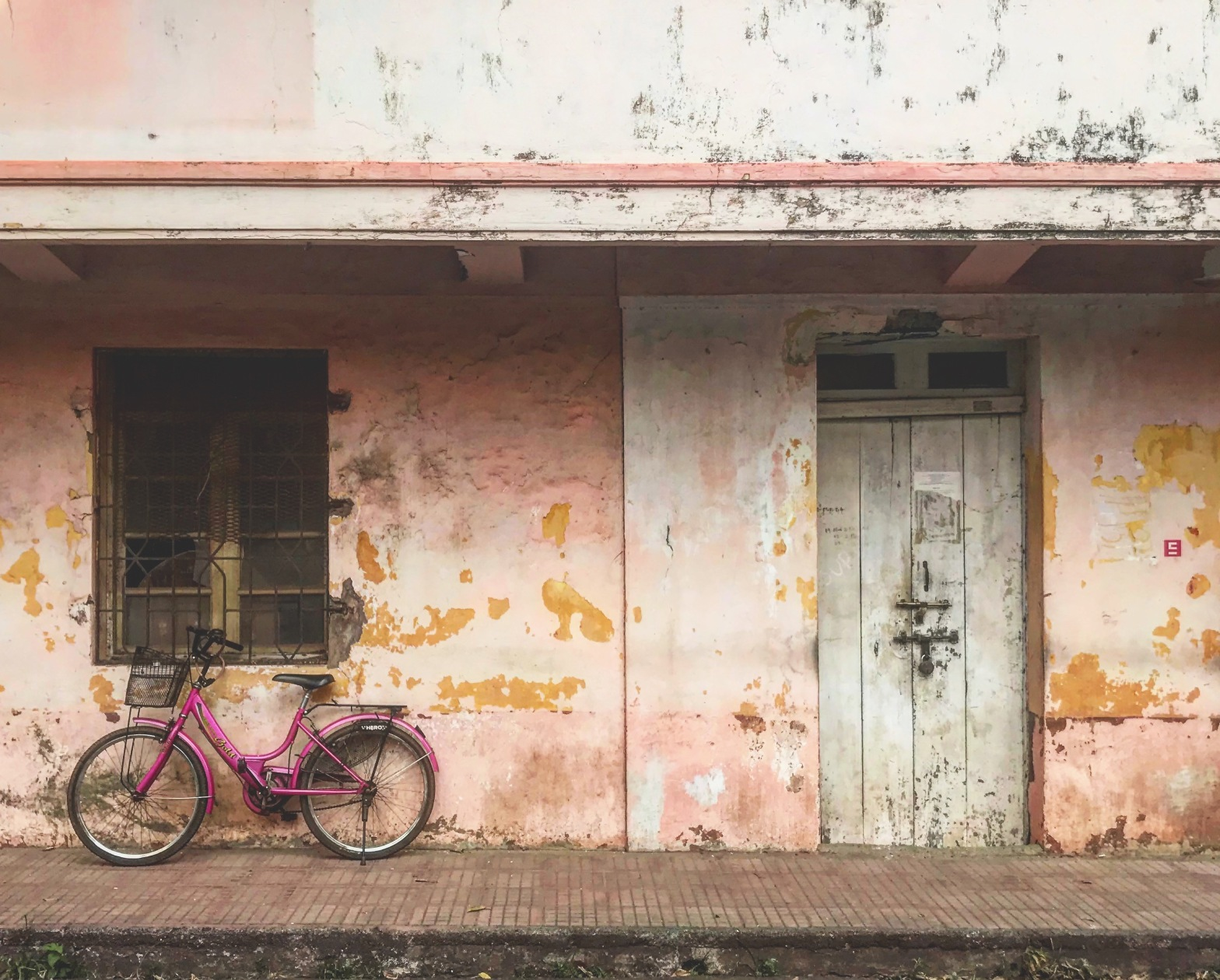 Bicycle outside worn weathered house